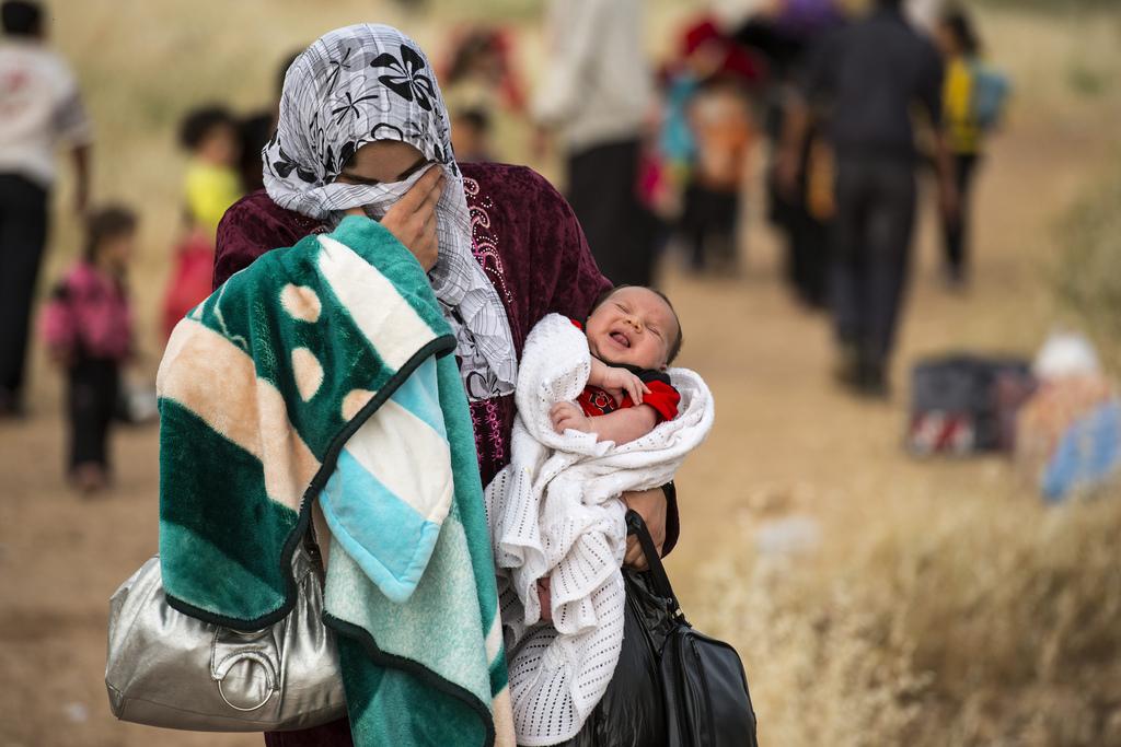 Sírios cruzam fronteira para fugir da violência e se tornam refugiados. Foto: ACNUR / S. Rich